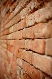Old red brick wall. Side view of old red brick wall with shallow depth of field Stock Images