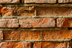 The old red brick wall. With cracks Stock Photo
