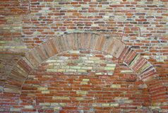 Old red brick wall with arch vintage texture background.  Royalty Free Stock Image