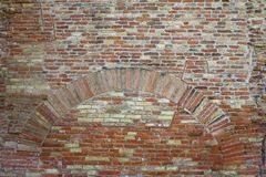 Old red brick wall with arch vintage texture background.  Royalty Free Stock Photos