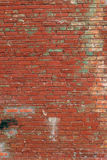 Old red brick wall in a background image. Texture background. Vintage effect. Background Stock Images