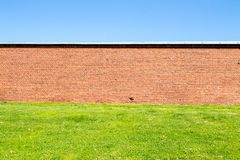 Old Red Brick Wall Behind A Field Of Grass Stock Images