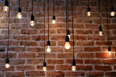 Old brick wall with bulb lights lamp. Old red brick wall with bulb lights lamp royalty free stock images