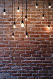 Old red brick wall with bulb lights lamp. With copyspace for text Stock Photos