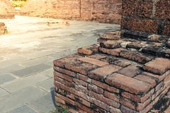 Old red brick wall with cement street at the park. Art Stock Images