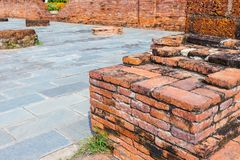 Old red brick wall with cement street at the park. Art Stock Image