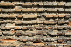 Old red brick wall corrugated Stock Image