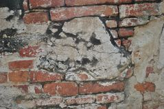 Old Red Brick Wall with Cracked Concrete Background Texture. Royalty Free Stock Photos