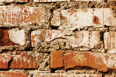 Old red brick wall with cracks and scuffs, style loft background Royalty Free Stock Images