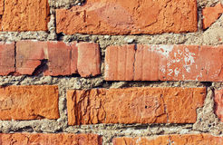 Old red brick wall with cracks and scuffs, style loft background Royalty Free Stock Photos