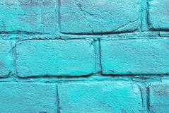 Old red brick wall with damaged white paint layer, closeup background photo texture. Seamless composition. Old red brick wall with damaged blue paint layer royalty free stock images