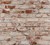 Old red brick wall with damaged bricks. Stock Images