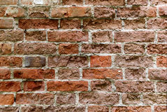 Old red brick wall with damaged bricks. Royalty Free Stock Photo