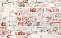 Old red brick wall with damaged white paint. Layer, closeup background photo texture. Seamless composition Royalty Free Stock Photos