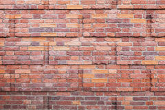 Old red brick wall with decorative relief Stock Photo