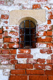 An old red brick wall with fallen off white plaster. Royalty Free Stock Photos