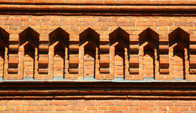 Old red brick wall fragment with arches. Horizontal architectural background Royalty Free Stock Images