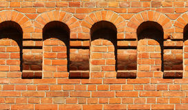 Old red brick wall fragment with arches. Horizontal seamless arc Stock Photo