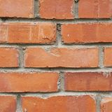Old red brick wall fragment Royalty Free Stock Image