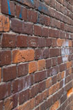Old red brick wall. With graffiti Royalty Free Stock Images