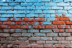 Old Red Brick Wall Half Painted In Bright Blue Stock Images