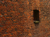 Old Red Brick Wall with lots of Texture and Color Stock Photo