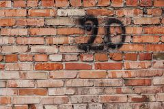 Red brick wall with number 20 Stock Photography