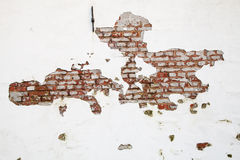 Old Red Brick Wall with Paint and Clay Peeling Off Royalty Free Stock Photography