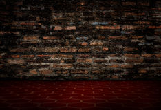 The old red brick wall and red tile floors. Royalty Free Stock Image