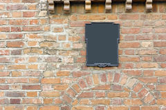 Old red  brick wall and  retro sign Royalty Free Stock Photography