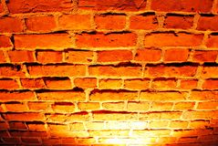 Old red brick wall with street light Stock Photos