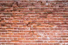 old red brick wall texture background. Distressed wall with broken bricks texture royalty free stock images