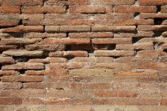 Old red brick wall texture background with scratches, cracks, dust, crevices, roughness. royalty free stock photography