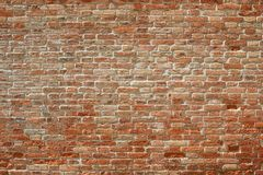 Old red brick wall texture background in sunlight