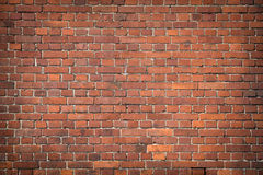 Old red brick wall texture grunge background with vignetted corners Royalty Free Stock Images
