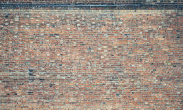 Old red brick wall texture. The texture of wall from a variety of old and dirty brick. Detailed pattern of a plurality of different sizes of brick red worn out Royalty Free Stock Image
