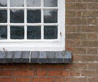 Old Red Brick Wall with White Cottage Window Stock Photo