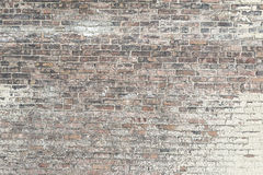 Old red brick wall with white paint background texture Royalty Free Stock Images