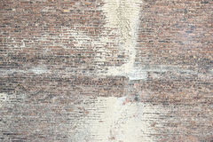 Old red brick wall with white paint background texture Stock Image