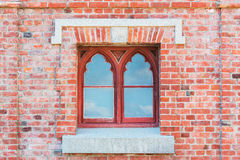 Old red brick wall with  Window. Old red brick wall with traditional Window Stock Photography