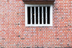 Old red brick wall with Window. Royalty Free Stock Photography