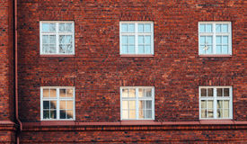 Old red brick wall with windows in Helsinki. Finland Stock Photography