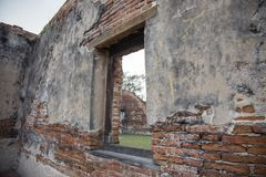 Old red brick wall with wood window in vintage interior. From old buddism temple in Thailand stock photography