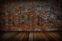 The old red brick walls and wood floors. Royalty Free Stock Photos