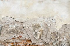 Old red brick and white plaster wall with cracked shabby surface texture background. Old red brick and white plaster grunge wall with cracked shabby surface royalty free stock images