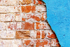 Old red bricks and blue stucco Royalty Free Stock Images