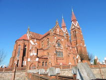 Old red bricks church, Lithuania. Beautiful old and high red bricks catholic church in Sveksna, Lithuania royalty free stock images