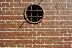 Old Red Bricks and circle window Stock Photos