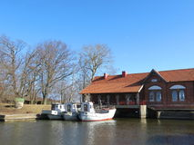 Old red bricks house and boats Royalty Free Stock Images