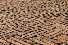 Old red bricks paving zigzag pattern Stock Photography